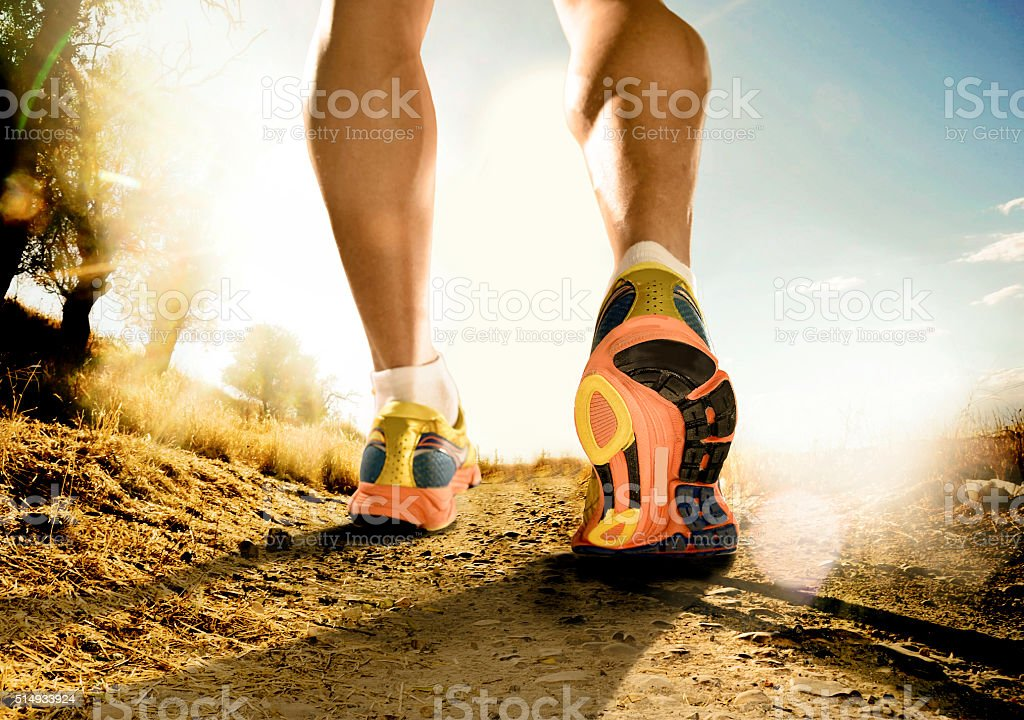 legs and shoes of sport man runner off road running stock photo