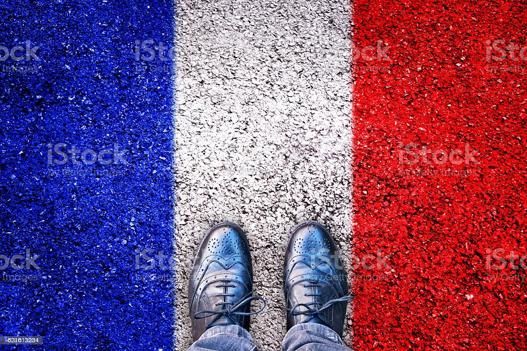 Legs and shoes on asphalt with french flag stock photo