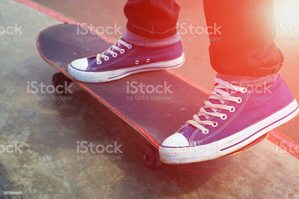 legs and the board skateboarder at start, sunny evening stock photo