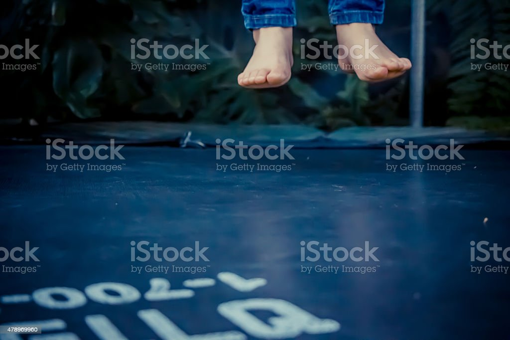 Legs floating in the air after jumping on the trampoline stock photo