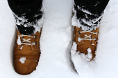 Legs in  boots in the snow. Winter