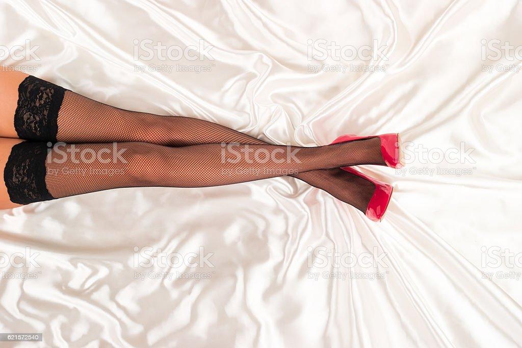 Legs in fishnet stockings stock photo