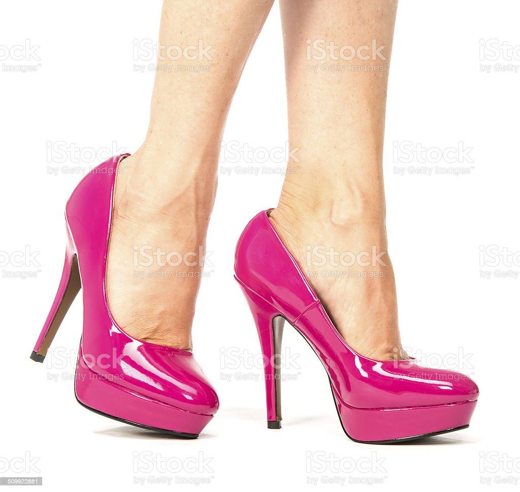 Legs in pink platform high heels pumps stock photo