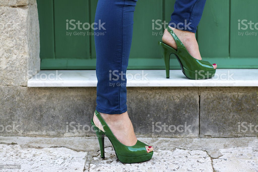 Legs in Sexy Green Heels and Skinny Jeans, Italy stock photo
