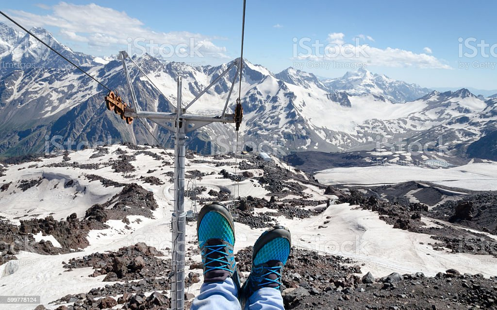 Legs in sneakers on a background of mountain landscape stock photo