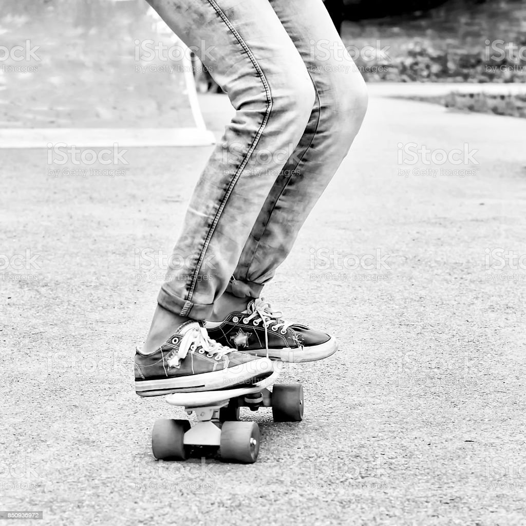 Legs in sneakers on a skateboard.Close-up. Sports. Healthy lifestyle. stock photo