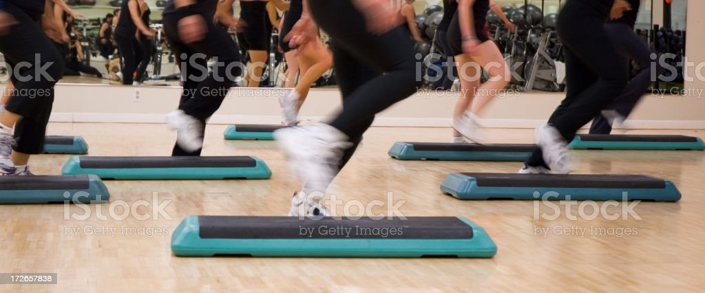 Legs in Step Aerobics Class royalty-free stock photo