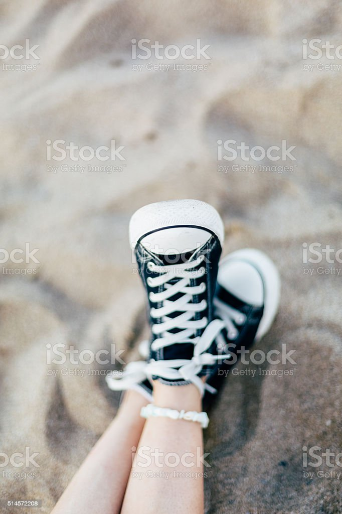 Legs in the sand stock photo