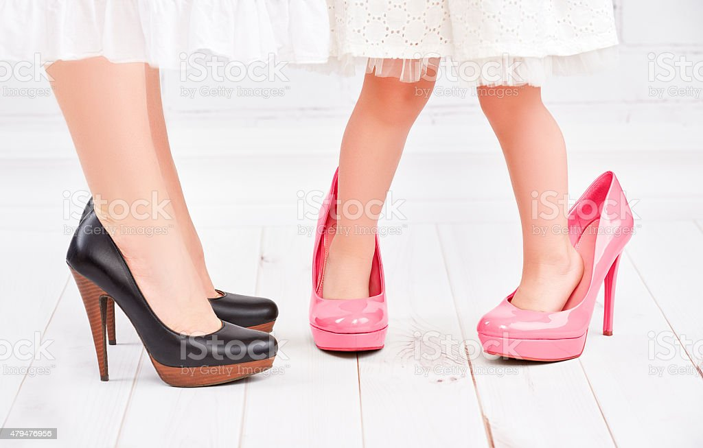 legs mother and daughter little girl fashionista in shoes stock photo