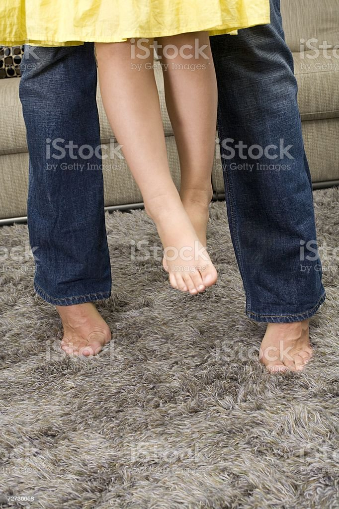 Legs of a father and daughter royalty-free stock photo