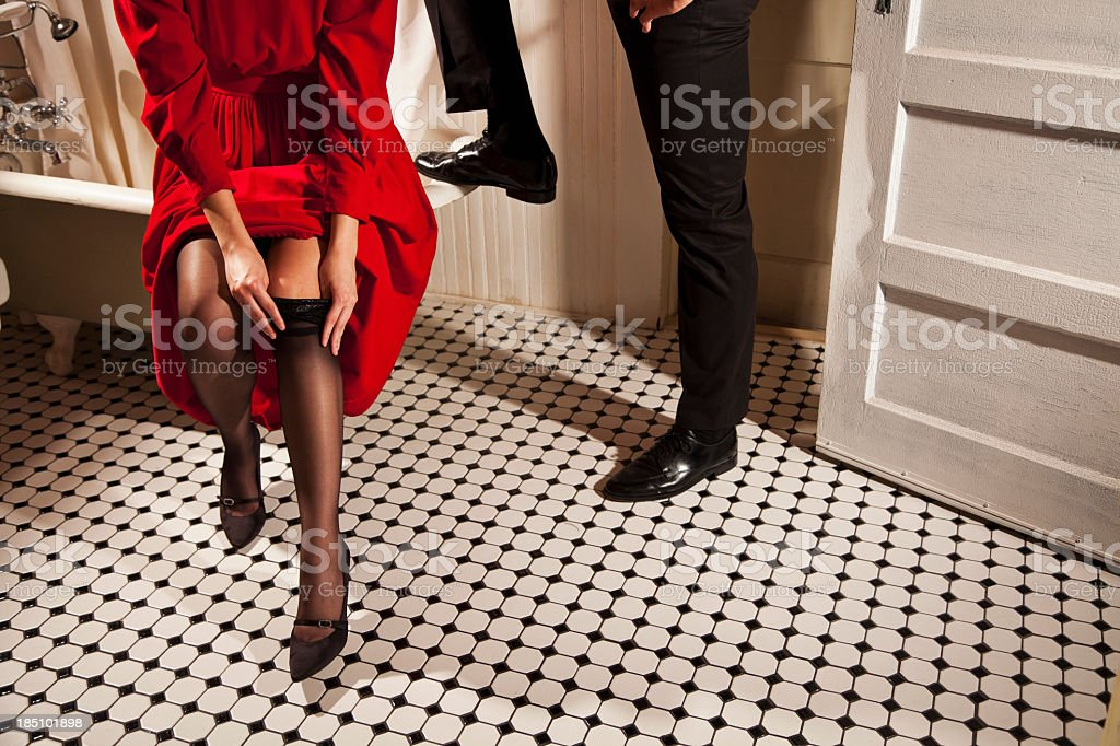 Legs of couple in bathroom royalty-free stock photo