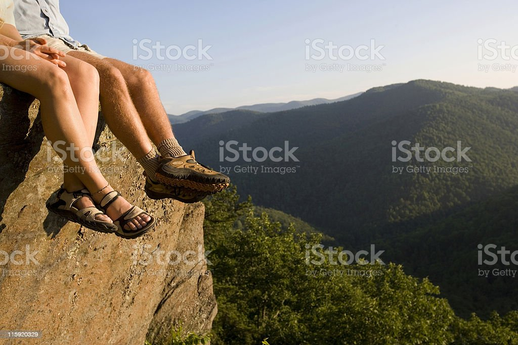 Legs of Couple Relaxing in Mountains stock photo
