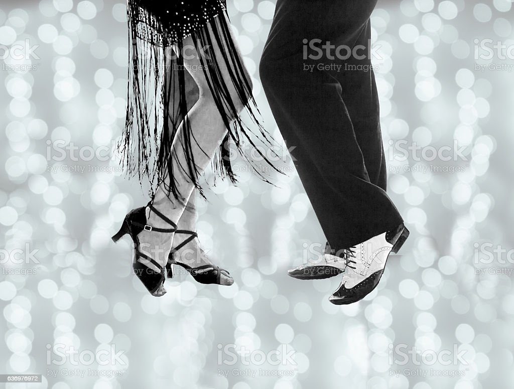 Legs of man and woman dancing stock photo