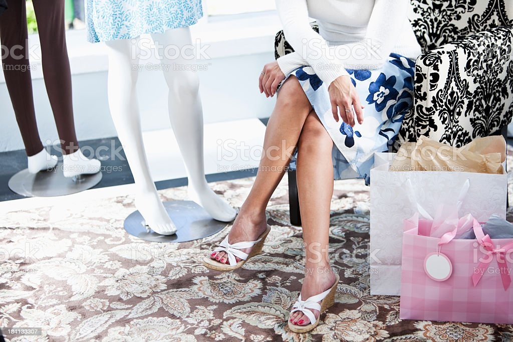 Legs of shopper in boutique stock photo