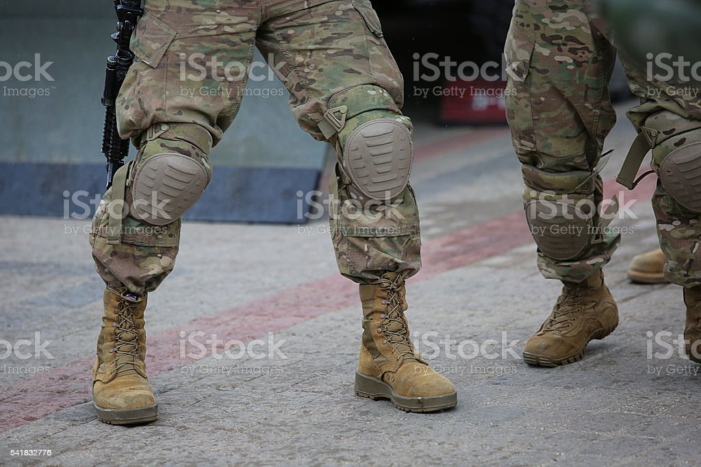 Legs of soldiers in camouflage stock photo