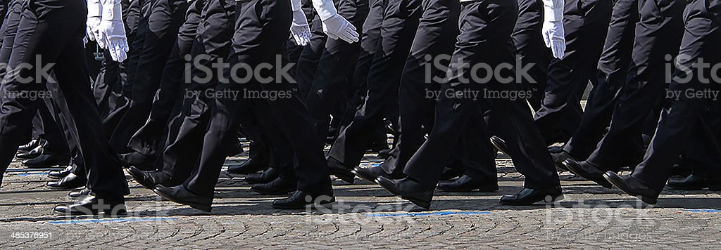 Legs of soldiers marching in the 14th of July stock photo