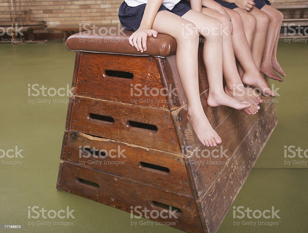 Legs of students in gym class royalty-free stock photo
