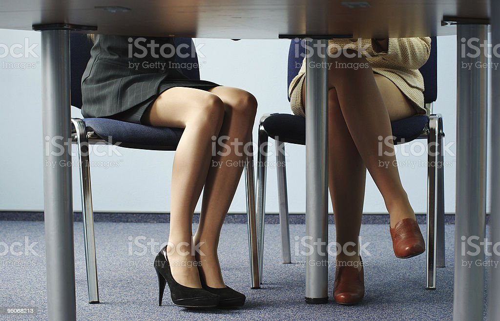 Legs of two businesswomen royalty-free stock photo