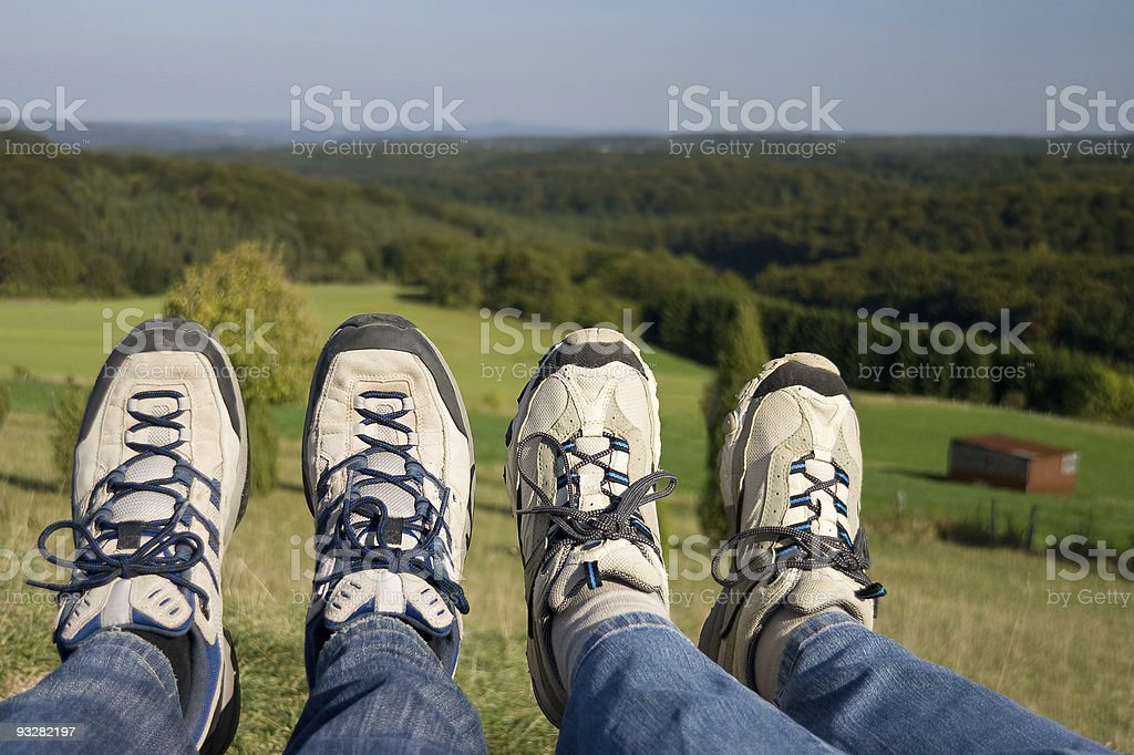 Legs of two hikers stock photo