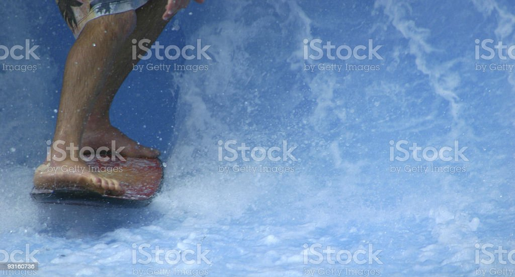 Legs of wavepark surfer royalty-free stock photo