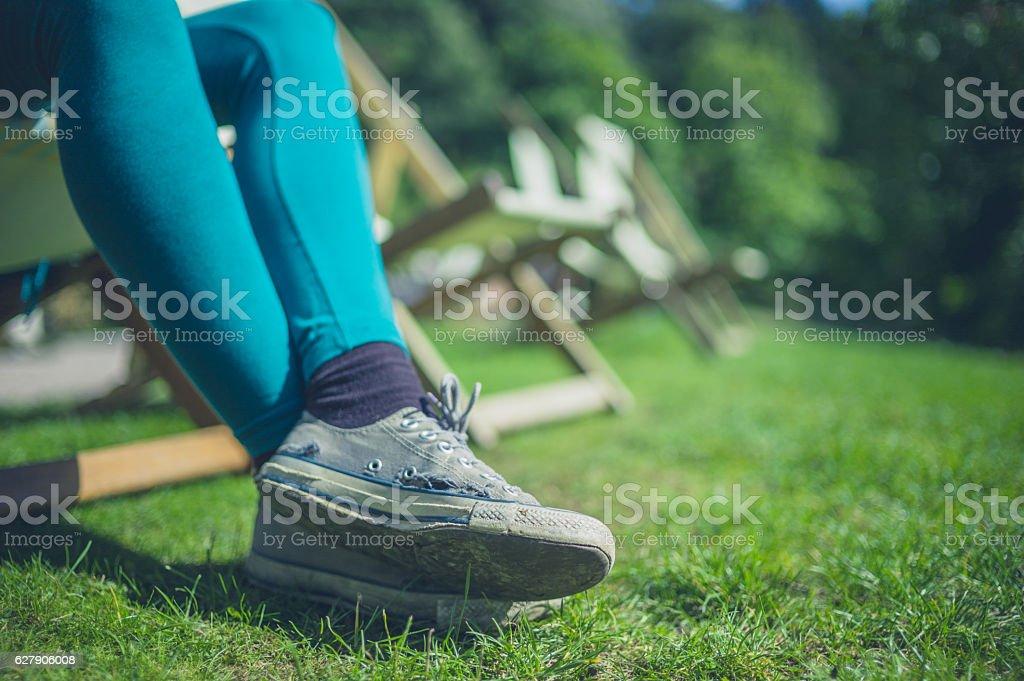 Legs of young woman relaxing in garden stock photo