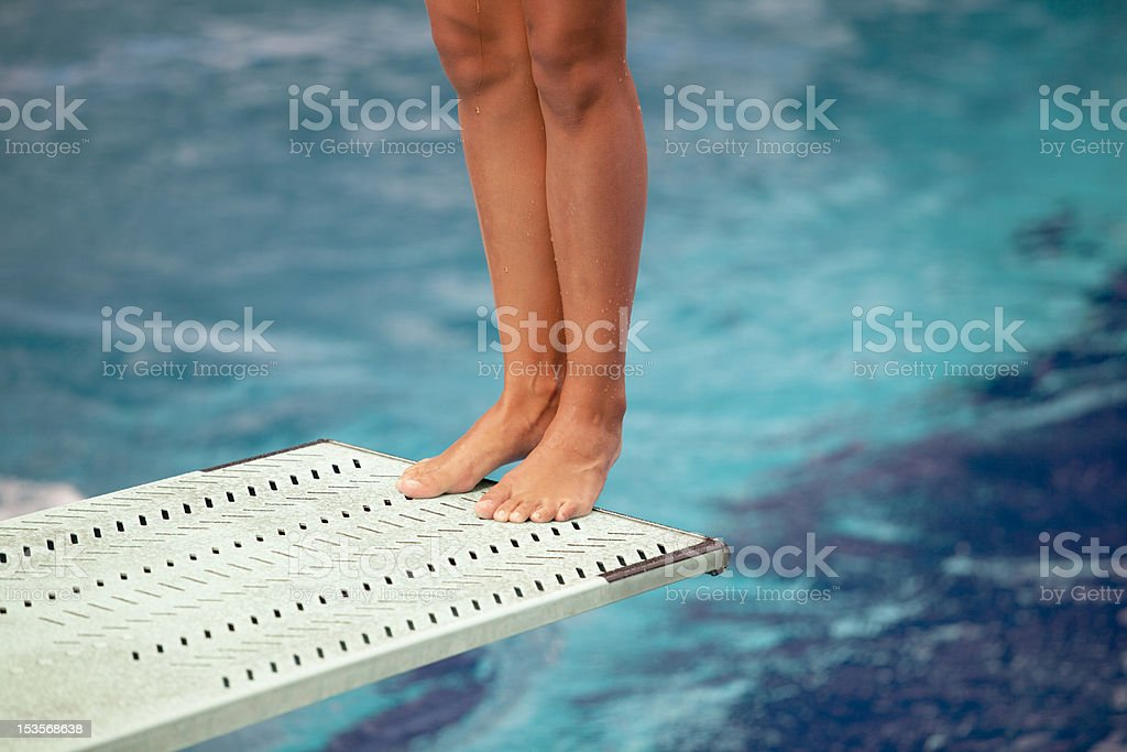 Legs on a springboard stock photo