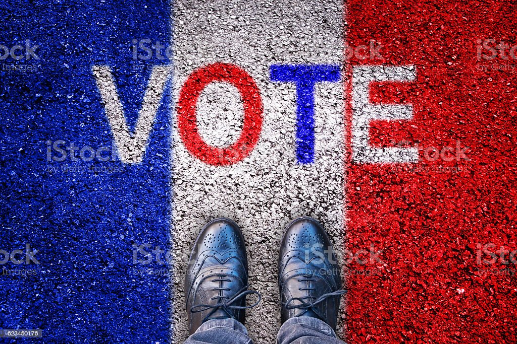 Legs on asphalt with french flag and the word 'vote' stock photo