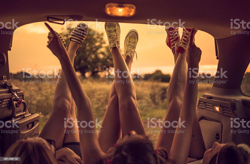 Legs on Road trip stock photo