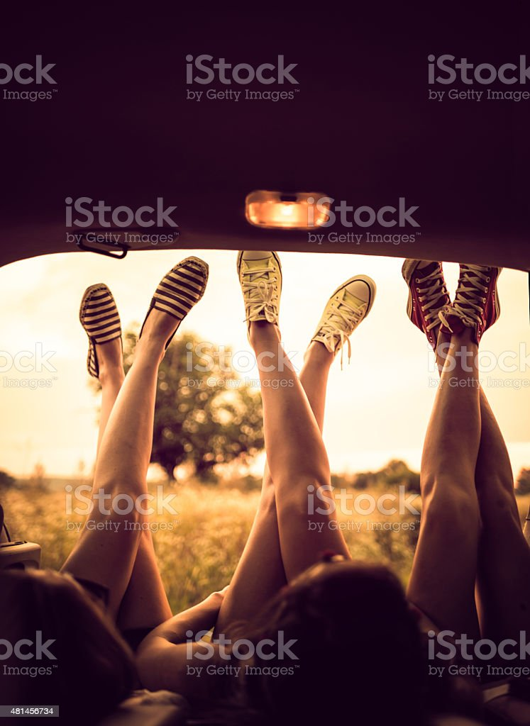 Legs on Road trip stock photo