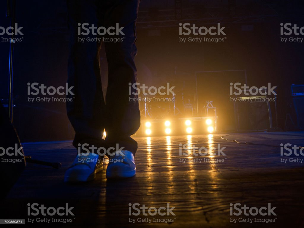 Legs on the concert stage stock photo