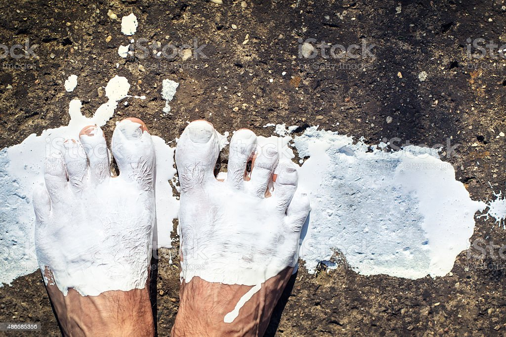legs painted with white color stock photo