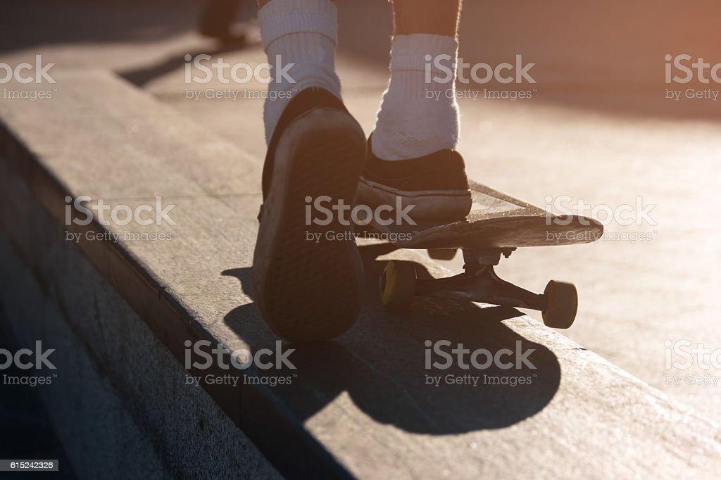 Legs riding on skateboard. stock photo