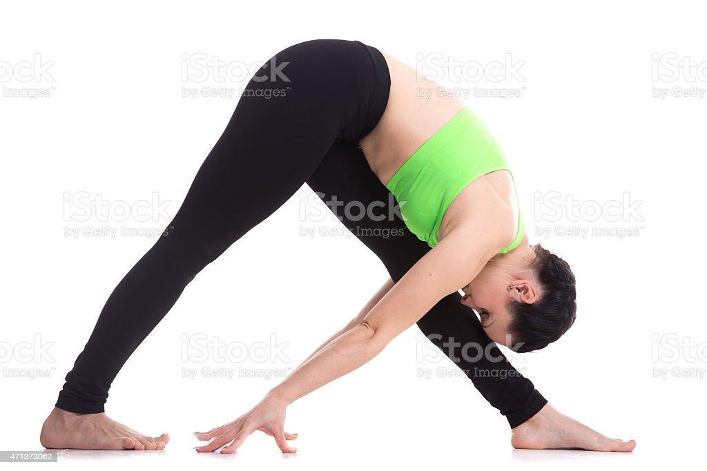 Legs stretching exercises, yoga pose parshvottanasana stock photo