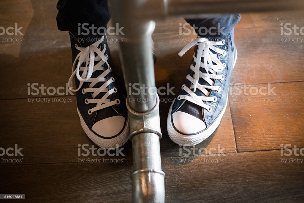legs under the table stock photo