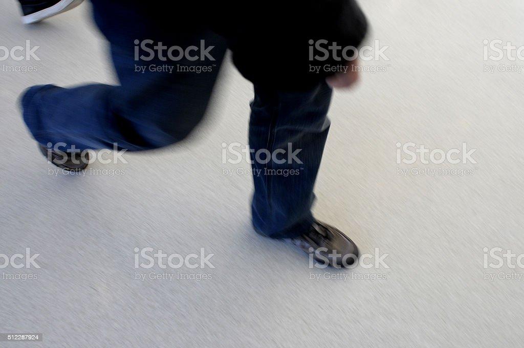 legs walking fast stock photo