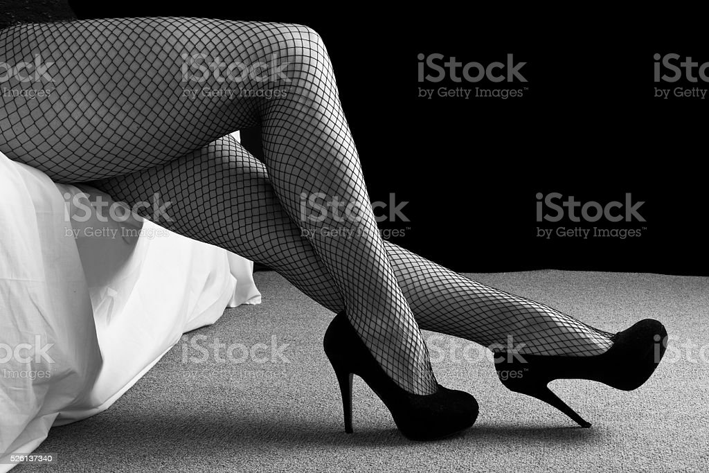 Legs with black high heal shoes stock photo