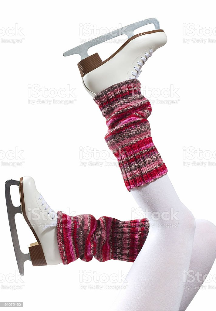 Legs with pink leg-warmers and skates kicking up into air royalty-free stock photo