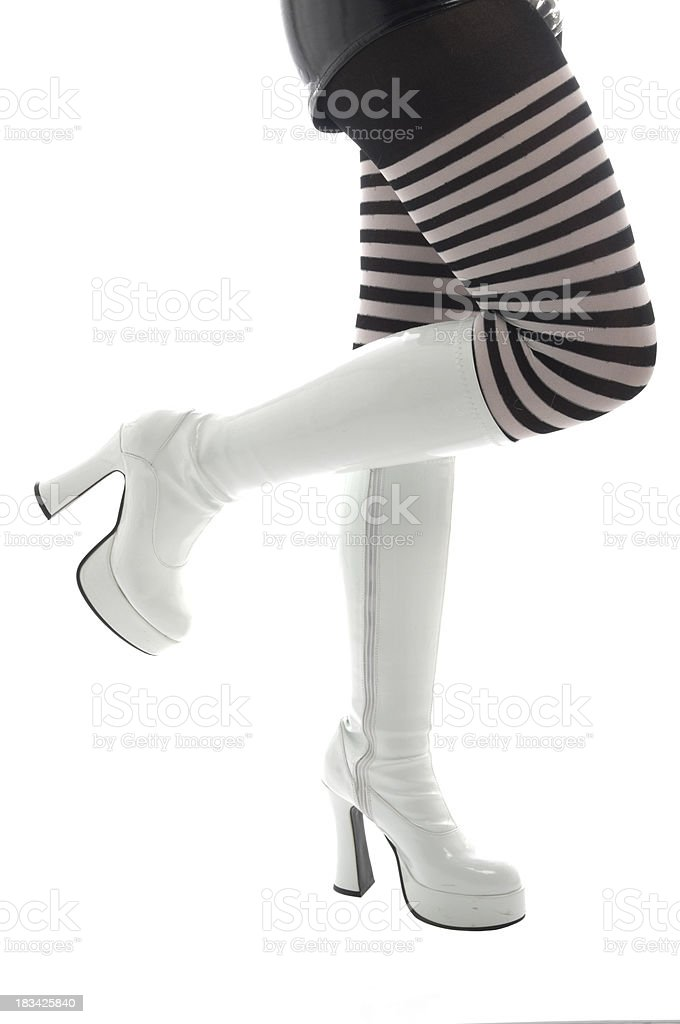 Legs with white boots and striped stockings. stock photo