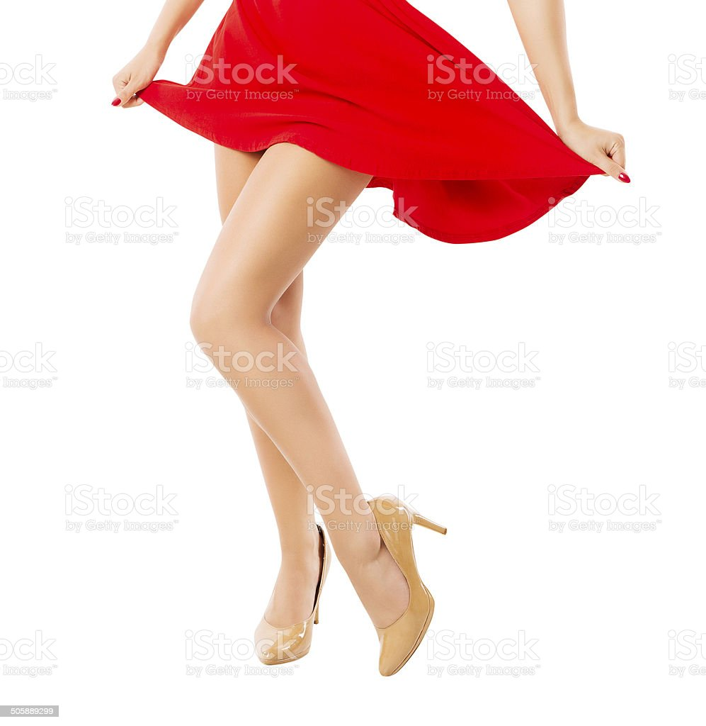 Legs woman dancing close up over white background stock photo