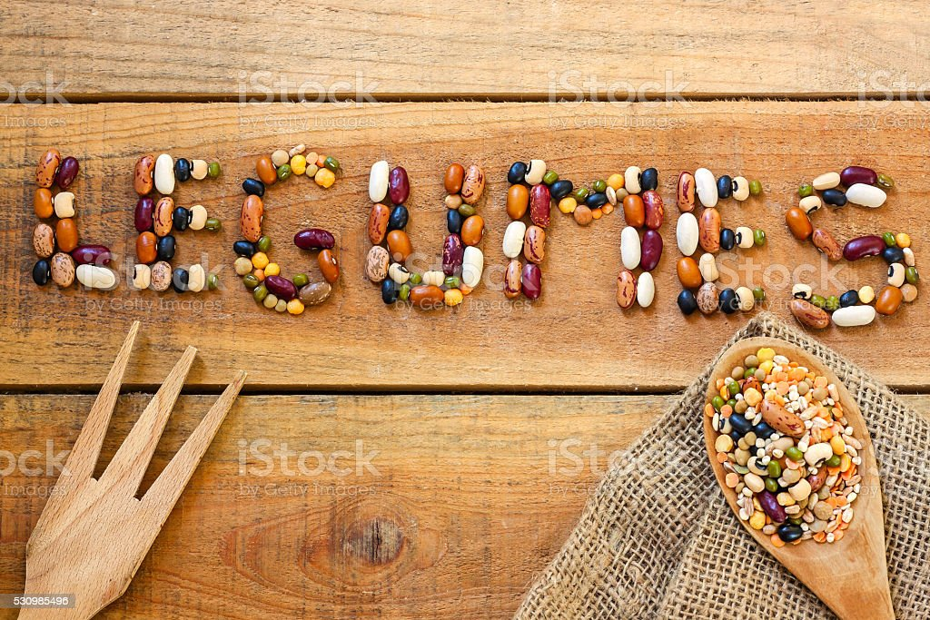 Legumes word with wood background stock photo
