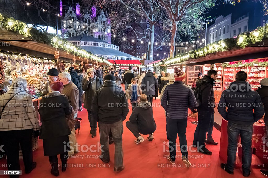 Leicester Square Christmas Market. People Shopping at  stalls. stock photo