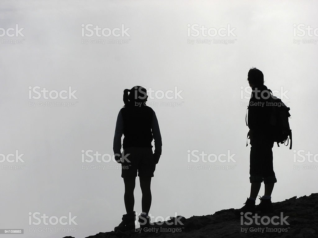 Leisure; Female hikers in silhouette royalty-free stock photo