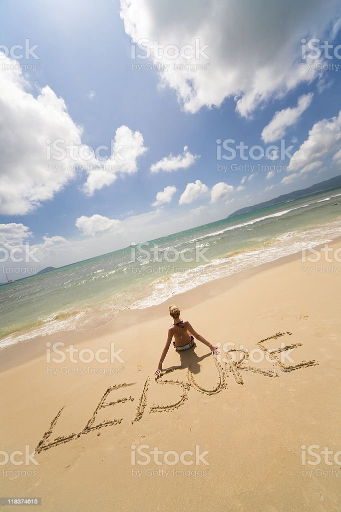 Leisure sing and woman on the beach stock photo