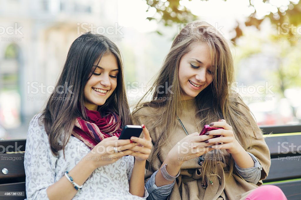 Leisure time with cell phone stock photo
