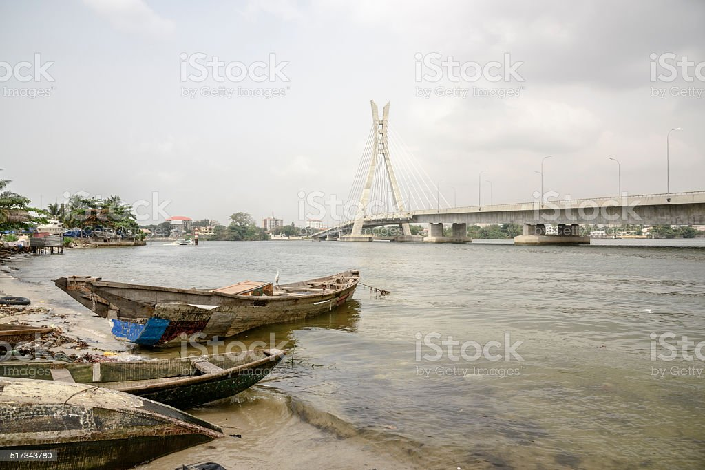 Lekki Ikoyi Bridge with fishing boat, Lagos, Nigeria stock photo
