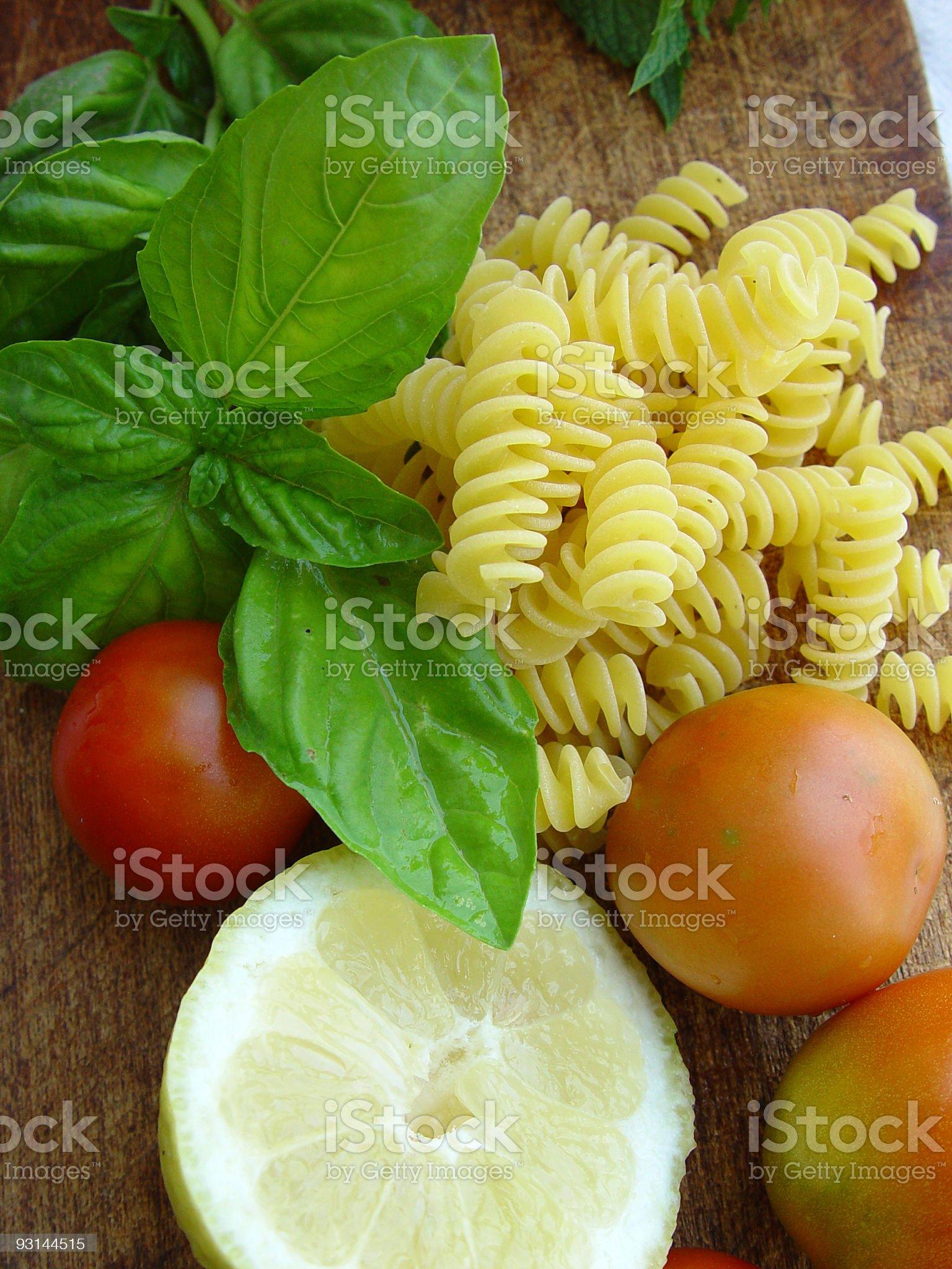 Lemmon, tomato, basil and pasta royalty-free stock photo
