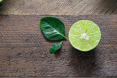 lemn ripe citrus on an old wooden table