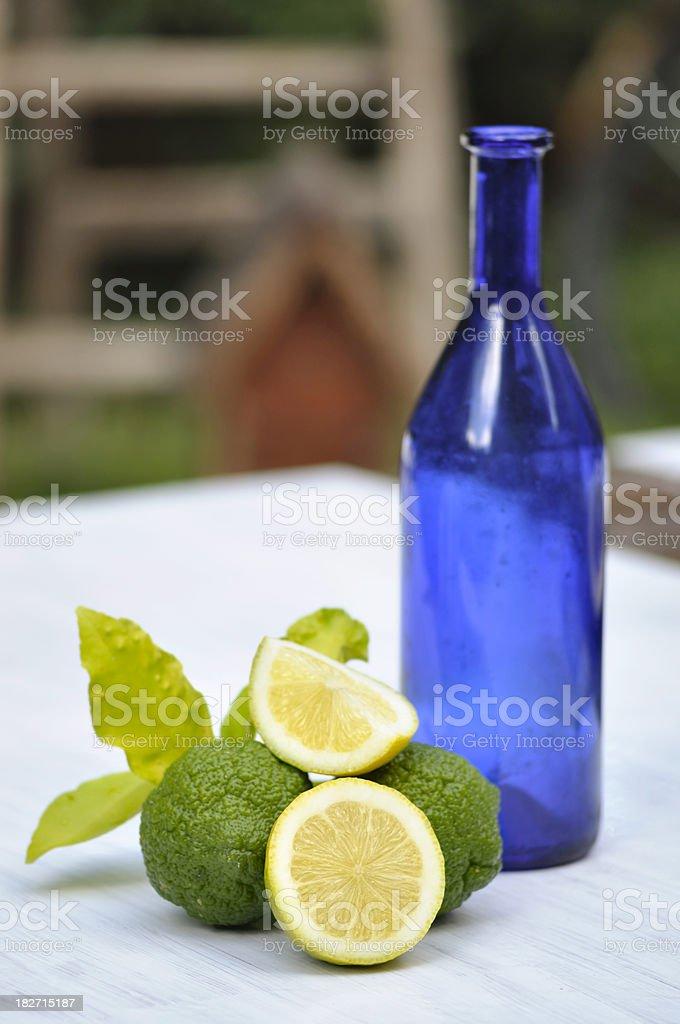 Lemon and bottle still life stock photo