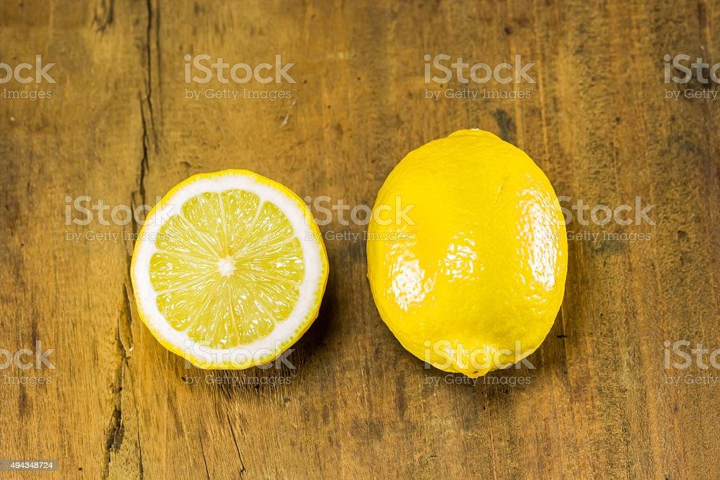 lemon and half on the wood background stock photo