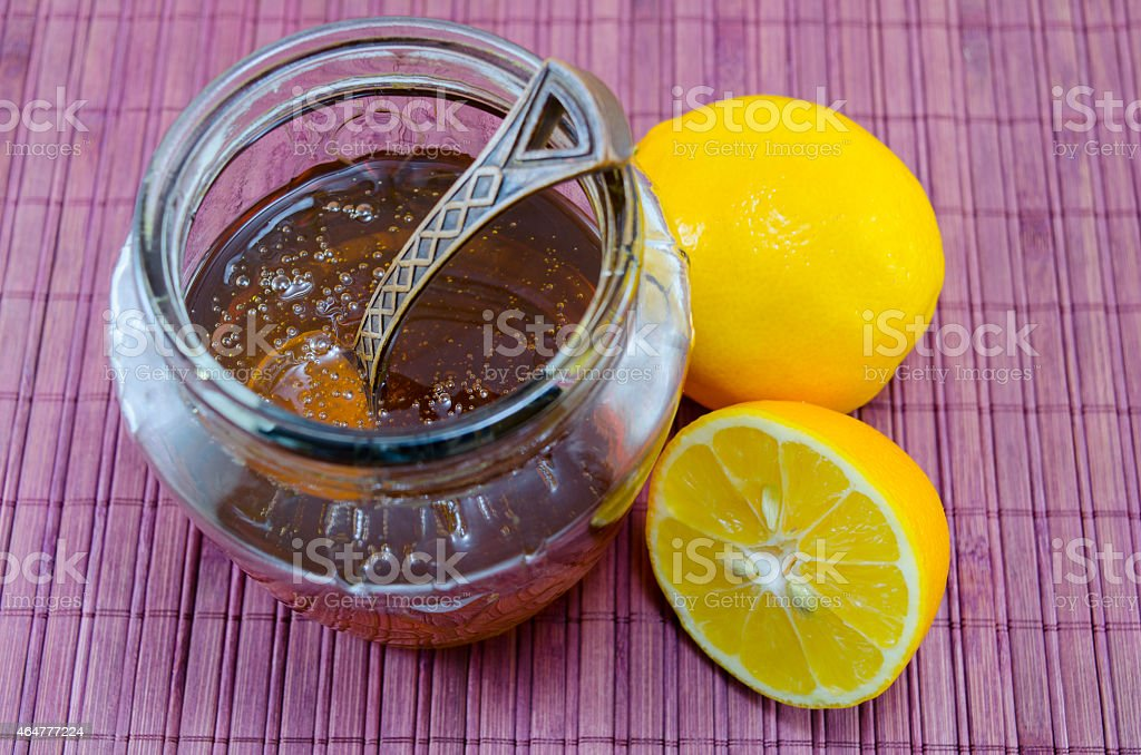 Lemon and honey in a jar royalty-free stock photo